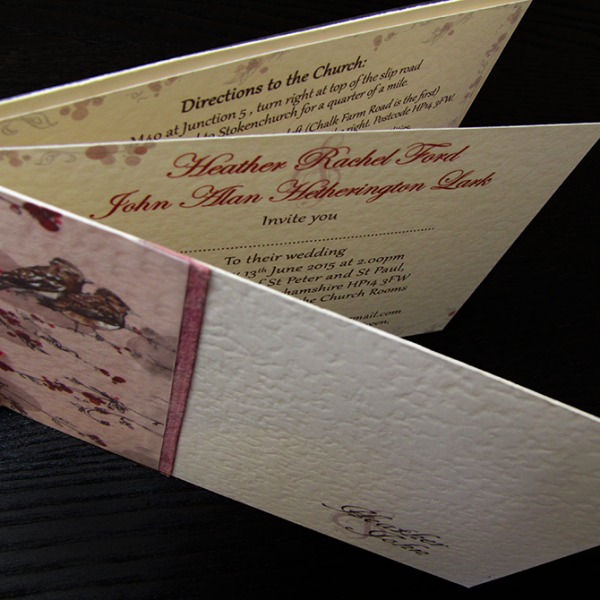 Wedding invitations with a lark theme, incorporating the couple-to-be's surname. Red and coral colour scheme.