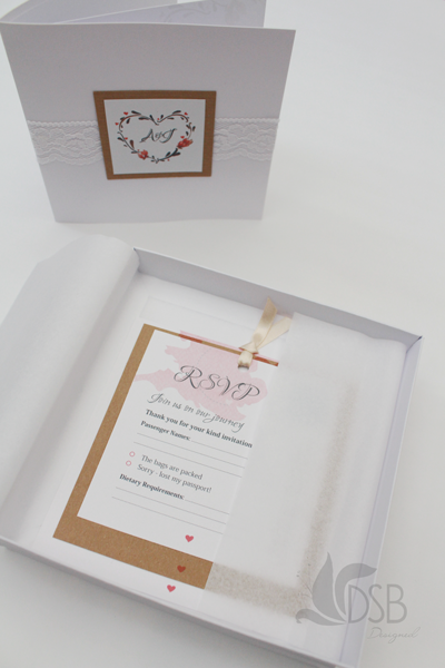 Revealed wedding stationery showing inserts and invitation.